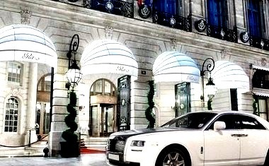 White And Black Rolls Outside Luxury Hotel